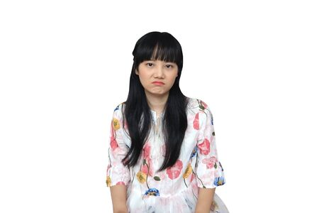 Cute Asian Girl Looking Unhappy. isolated on White Background.