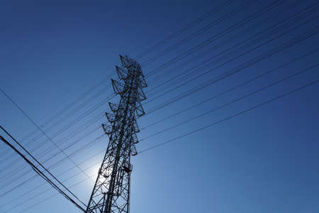 Transmission tower standing in the blue sky