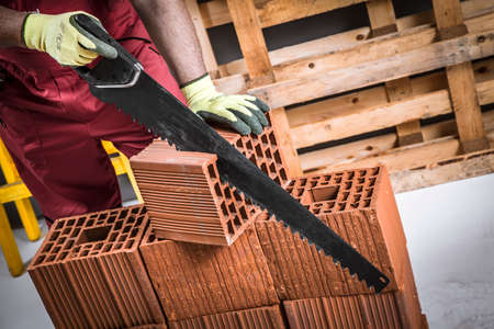 high visibility: Man working with the saw