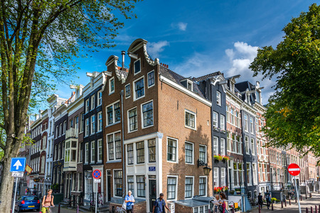 Nice corner in Amsterdam, showing the typical narrow houses with the sloping facade.