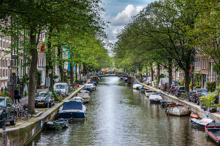View of the Egelantiersgracht canal street from the bridge in Prinsengracht street in Amsterdam.