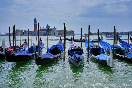 Blue gondolas in Piazza San Marcos with Saint Giorgio Maggiore island in the background
