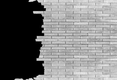 foundation cracks: brick wall with hole Isolated on black background for design texture pattern and background. Stock Photo
