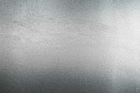 Glänzende silbergraue Folienbeschaffenheit für den Hintergrund