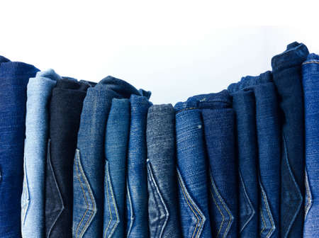 jeans stacked on white background blank for design and text input.