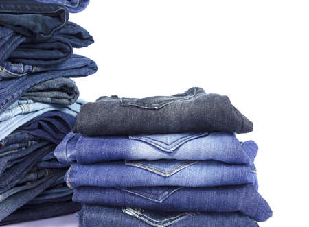 jeans stacked isolated on white background. Фото со стока