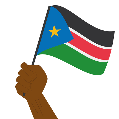 south sudan: Hand holding and raising the national flag of South Sudan