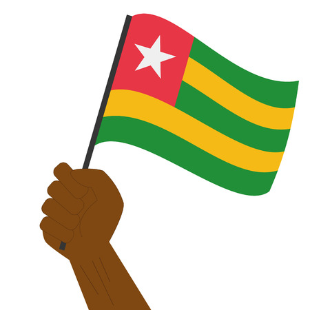 sovereignty: Hand holding and raising the national flag of Togo Illustration