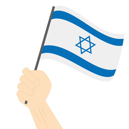 jewish community: Hand holding and raising the national flag of Israel