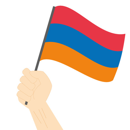 sovereignty: Hand holding and raising the national flag of Armenia