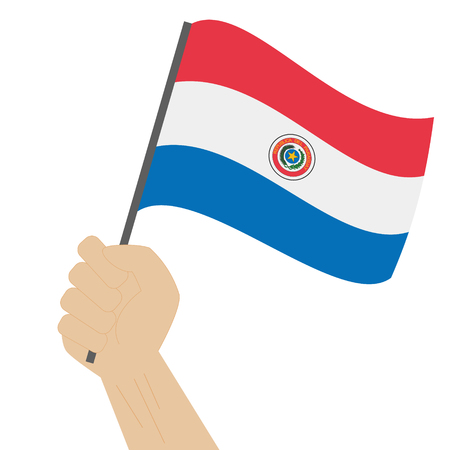 raise hand: Hand holding and raising the national flag of Paraguay