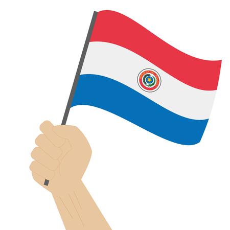 bandera de paraguay: Mano que sostiene y levantando la bandera nacional de Paraguay