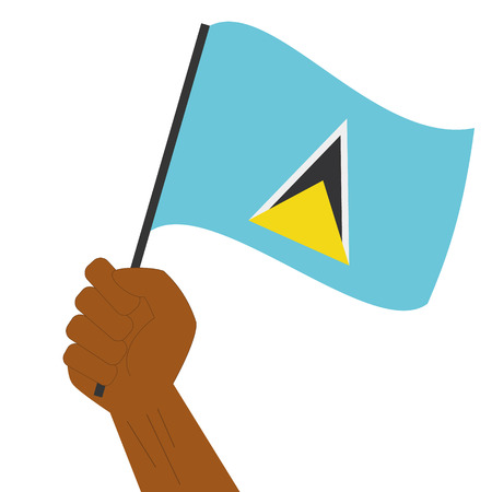 sovereignty: Hand holding and raising the national flag of Saint Lucia
