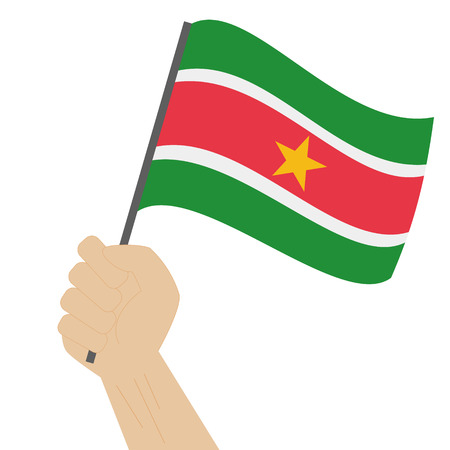 sovereignty: Hand holding and raising the national flag of Suriname