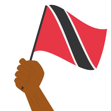 Hand holding and raising the national flag of Trinidad and Tobago