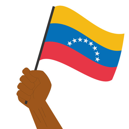 Hand holding and raising the national flag of Venezuela