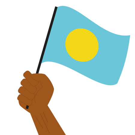 raise hand: Hand holding and raising the national flag of Palau