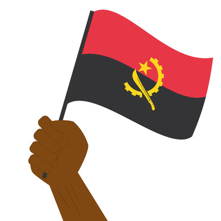 Hand holding and raising the national flag of Angola