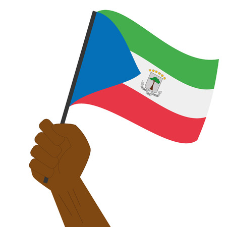 detailed image: Hand holding and raising the national flag of Equatorial Guinea