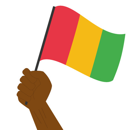 sovereignty: Hand holding and raising the national flag of Guinea