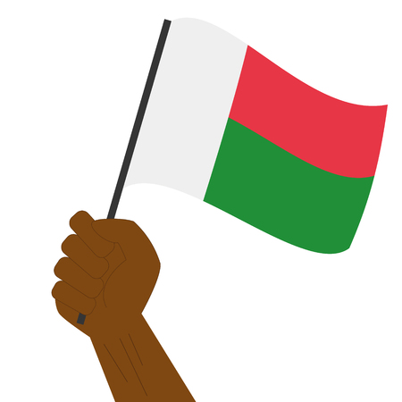 sovereignty: Hand holding and raising the national flag of Madagascar