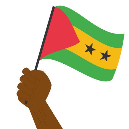principe: Mano que sostiene y levantando la bandera nacional de Santo Tomé y Príncipe