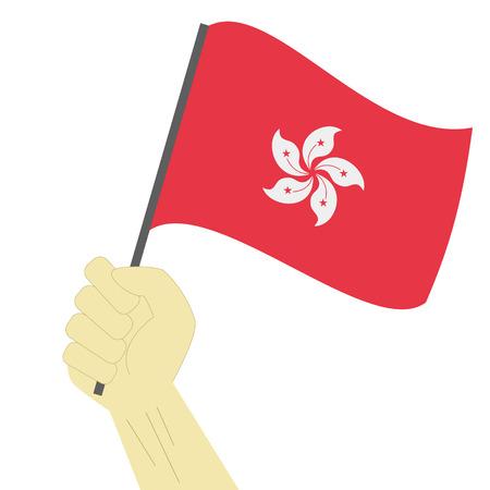 Hand holding en het verhogen van de nationale vlag van Hong Kong