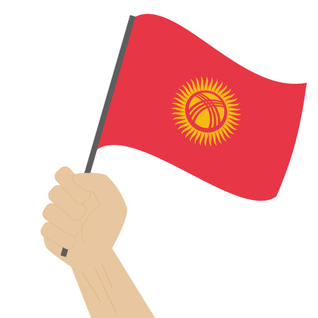 sovereignty: Hand holding and raising the national flag of Kyrgyzstan