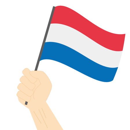Hand holding and raising the national flag of Netherlands