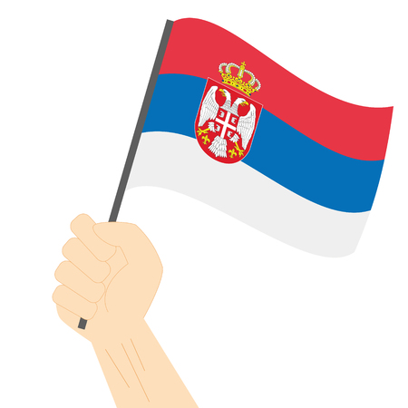 sovereignty: Hand holding and raising the national flag of Serbia