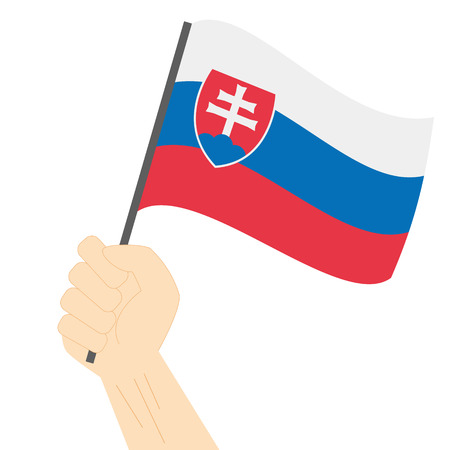 Hand holding and raising the national flag of Slovakia