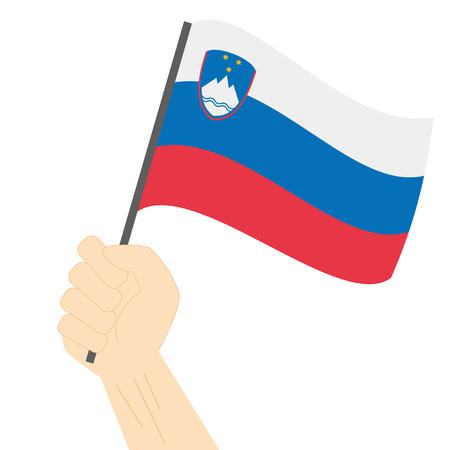 Hand holding and raising the national flag of Slovenia Illustration