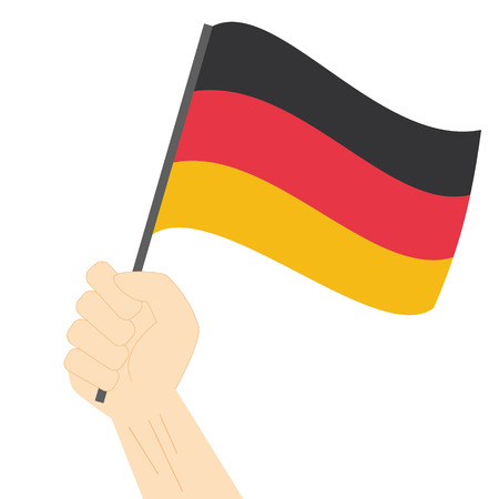 sovereignty: Hand holding and raising the national flag of Germany