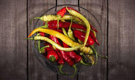 red hot chili pepper corns and pods on dark vintage metal culinary background Reklamní fotografie