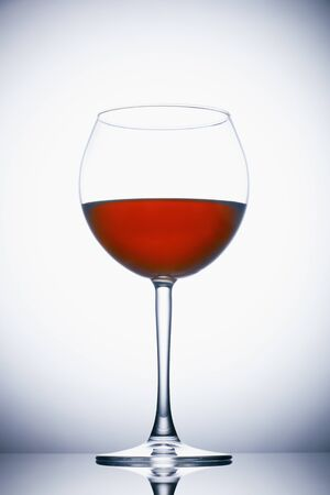 Glass of red wine on white Stockfoto