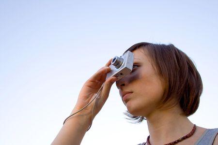 photocamera: Woman with photocamera Stock Photo