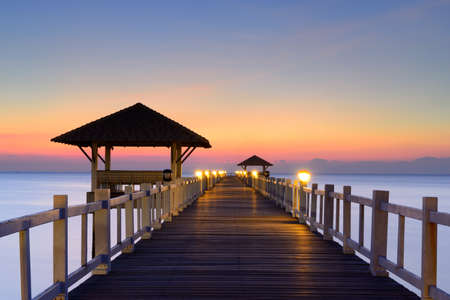 Wooded bridge in the port between sunrise in thailand photo