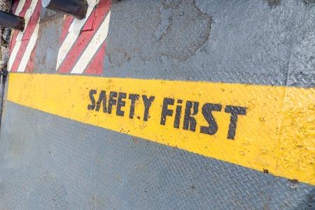 Safety First sign on caution strip. Foto de archivo