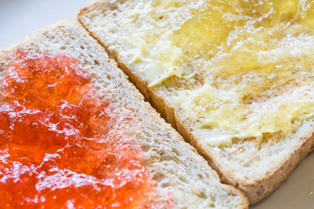 bread and butter: Bread butter and jam orange marmalade strawberry and berry. Stock Photo
