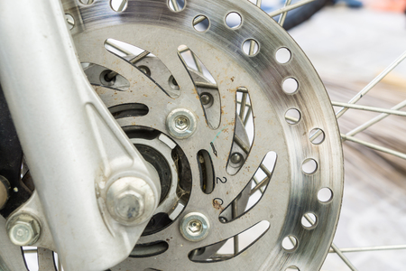 secure brake: Front motorcycle disk breaks  in close up Stock Photo
