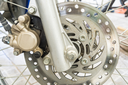 secure brake: Front motorcycle disk breaks and tire in close up