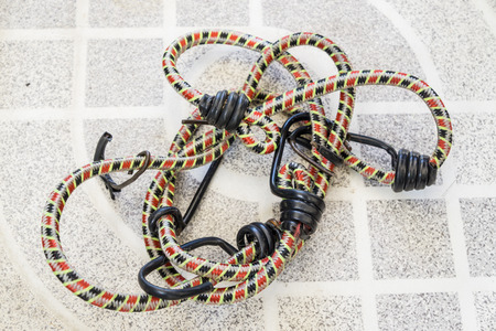 entanglement: Rope laid on the concrete floor