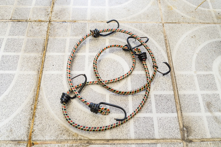 braided flexible: Rope laid on the concrete floor