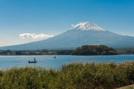 kawaguchi: Mount Fuji from Kawaguchiko in march.Snow-capped Mount Fuji with clear sky background Stock Photo