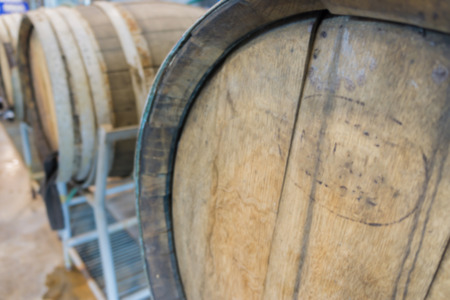wood staves: blurred background of old oak barrel