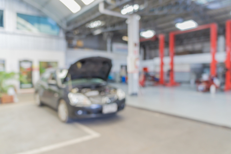 garage background: Blurred of car technician repairing the car in garage background. Stock Photo