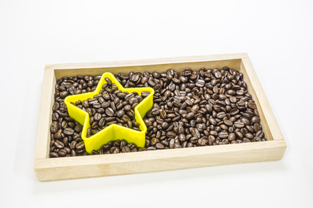 registros contables: born to be  the star.Business concept. Calculator on coffee beans background