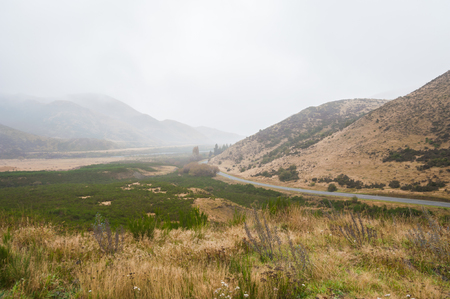 newzealand: New Zealand country road on a rainy day. road landscape view in newzealand