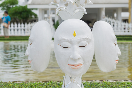 unconventional: Statue of mythological head in Wat Rong Khun. Wat Rong Khun is a contemporary unconventional Buddhist temple in Chiang Rai, Chiangmai province, Thailand.