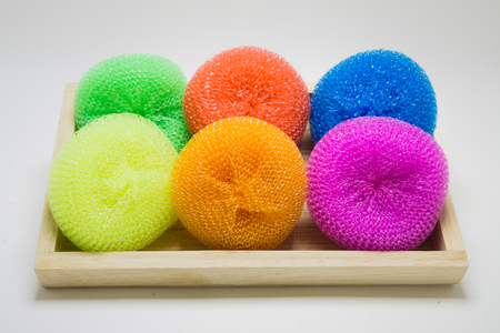 bath sponge: colorful Bath Sponge in wooden box on white background Stock Photo
